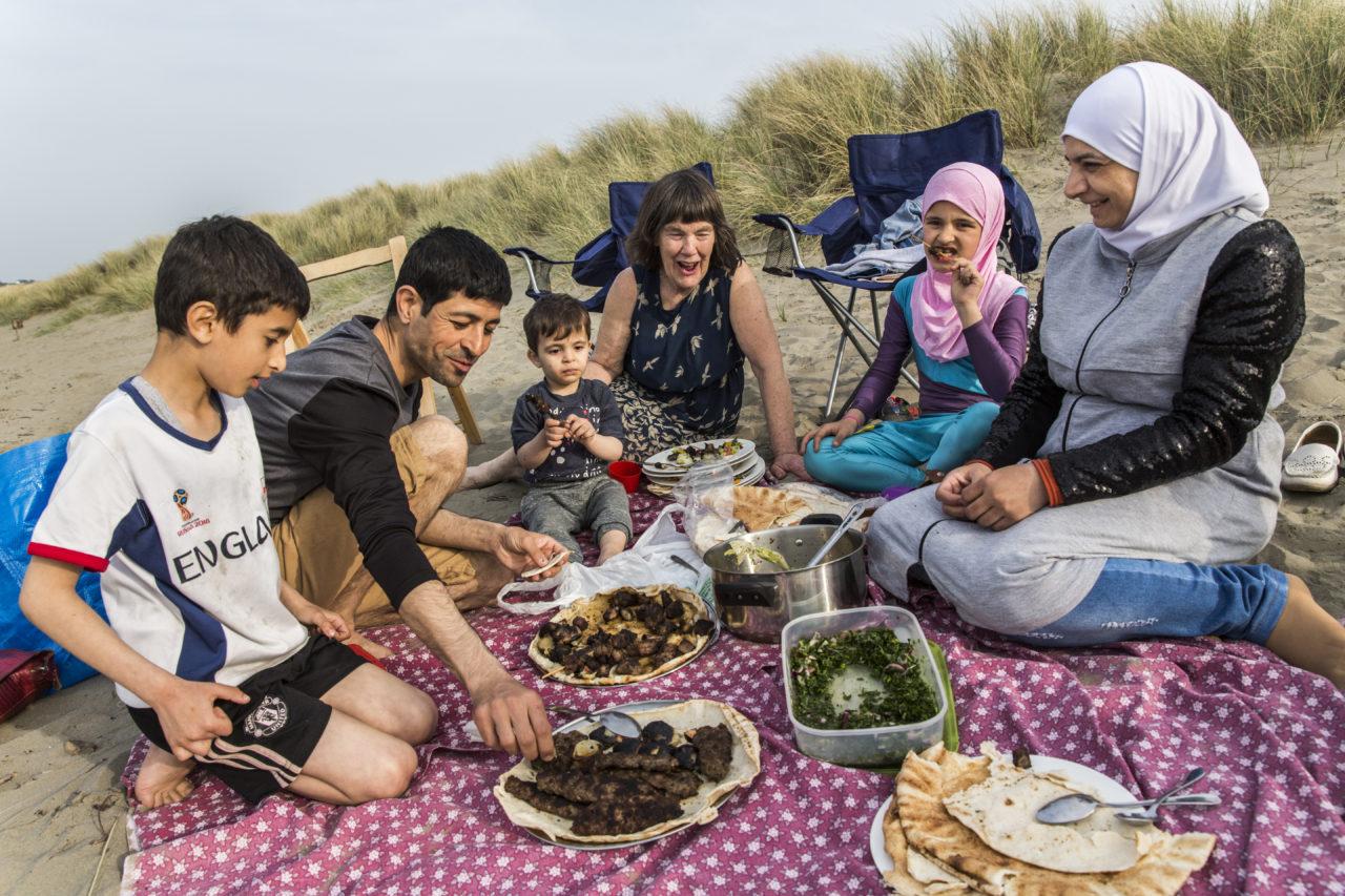 United Kingdom. Community volunteers help Syrian family integrate in Wales