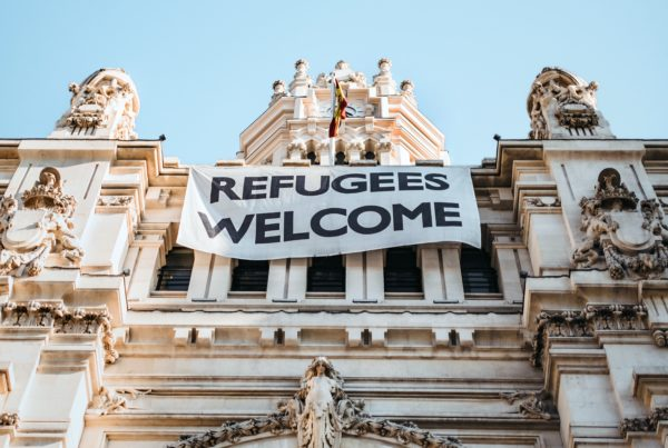 building with a sign saying refugees welcome