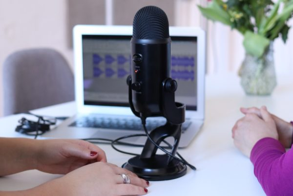 pairs of hands by a microphone
